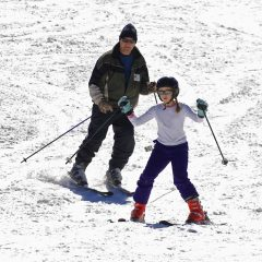Parent and child skiing