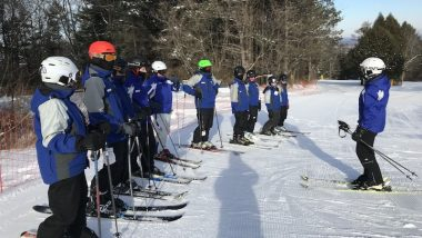 Instructors in a skiing clinic